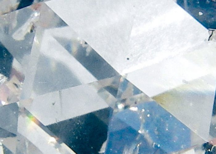 Close-up of a manufactured diamond with an NV center that is used in Scanning NV magnetometry